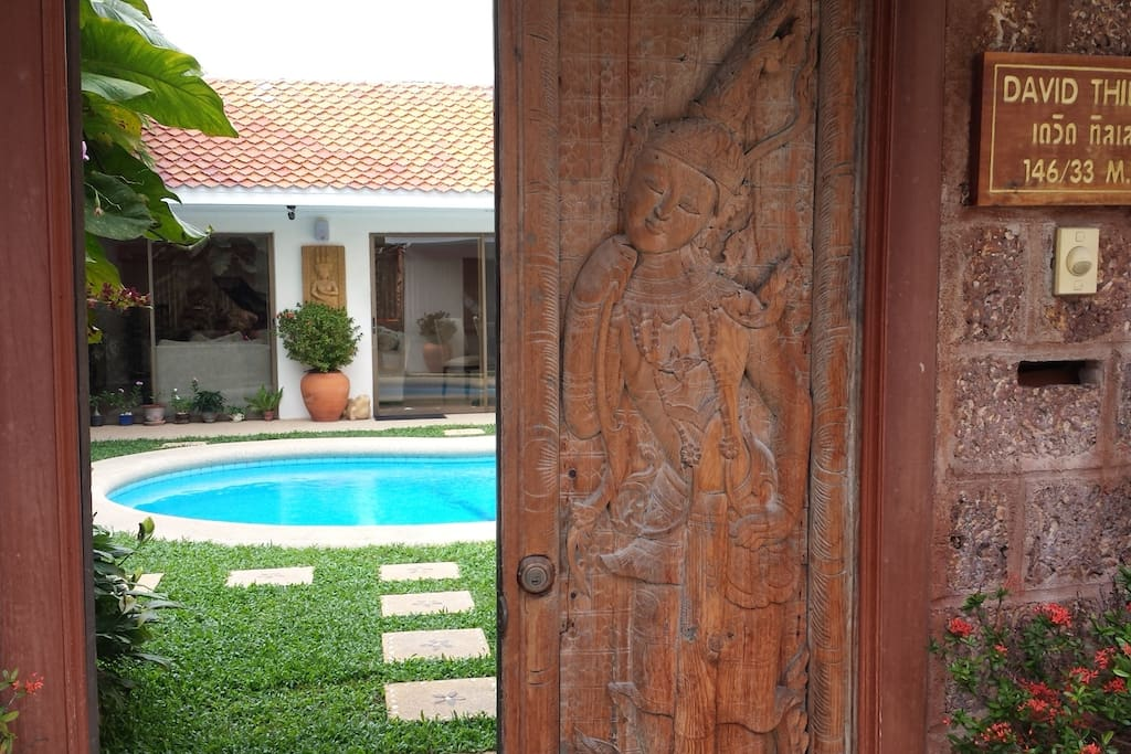 Welcome into the villa via hard carved teak wood doors. Looking at living room/dining room.