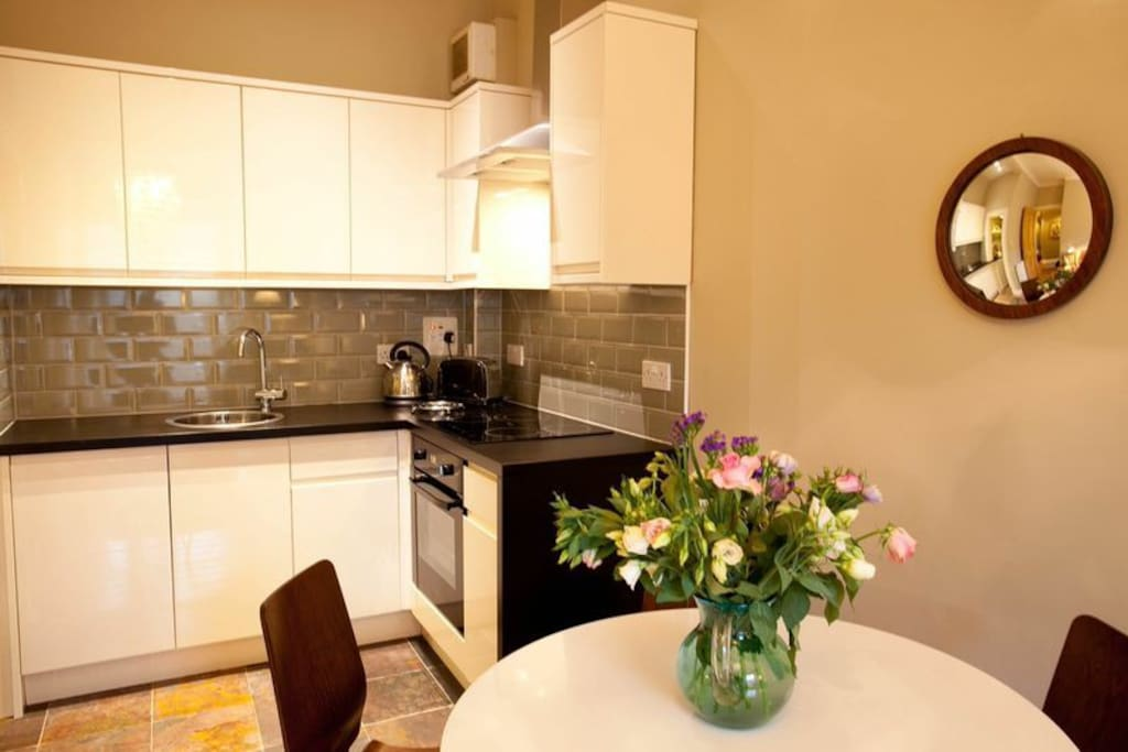 Dining kitchen with dishwasher, hob, oven, washing machine and microwave.