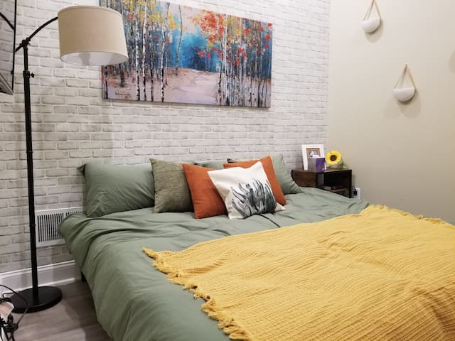 """Bedroom has a King-Size Zinus 12"""" memory foam mattress so you will have a superior sleep experience."""