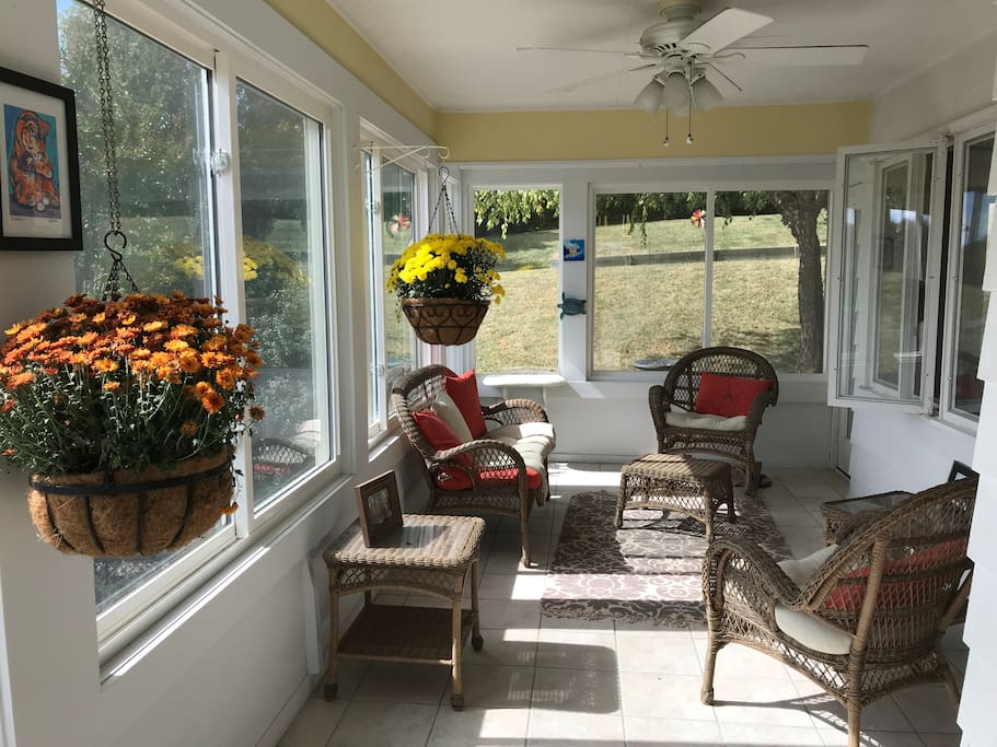 Take a break, put your feet up, and enjoy our lovely sun room upstairs!
