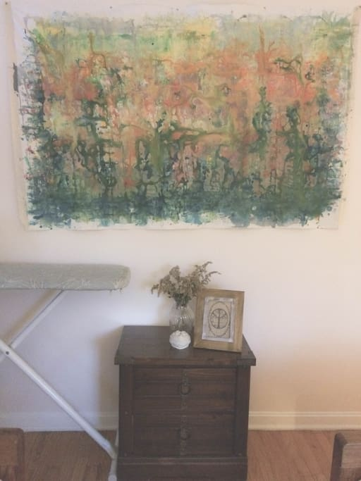 Guest room with painting, dresser and in-room closet available for use