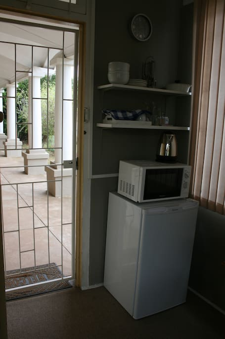 Kitchenette area with bar fridge, microwave and kettle