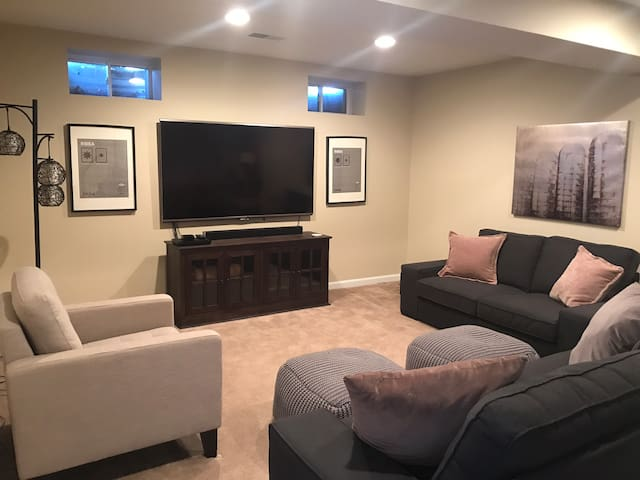 Spacious living area with two couches and chair.  Huge smart TV for watching your favorite streaming services.