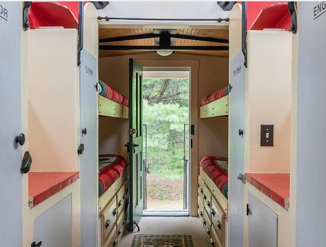 Bunk area in the Caboose, four twin beds. Two upper bunks do have bed rails for smaller children. Middle drawers pull out and are actually steps up to top bunks.