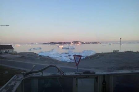 Whales breathing,Iceberg breaking in Qasigiannguit