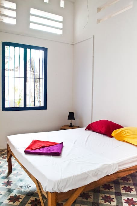 room 2, 1 double bed, fan, private bathroom cold water, terrace attached, 13 USD/night