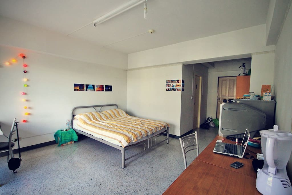 Room with double bed, TV, Fridge and Desk