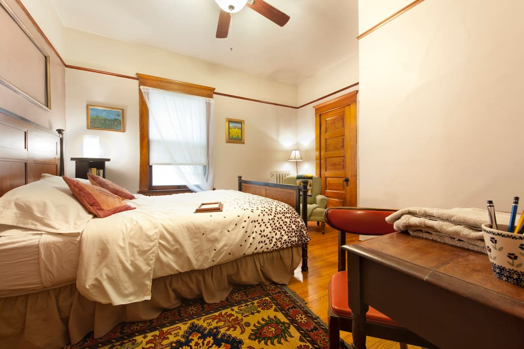 Both guest rooms include window AC units and queen beds.