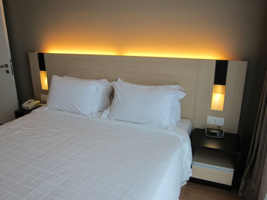 King size bed in master room with comfy mattress & pillows