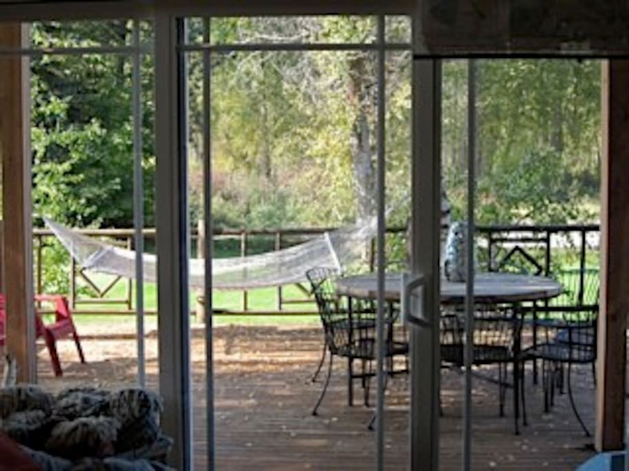 A view of the 900 sq. ft.deck that overlooks the Icicle River.