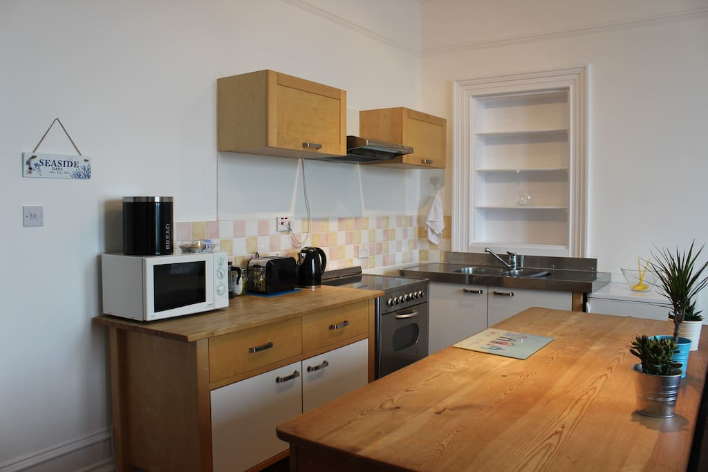 Fully equipped free standing kitchen with huge wooden work bench.