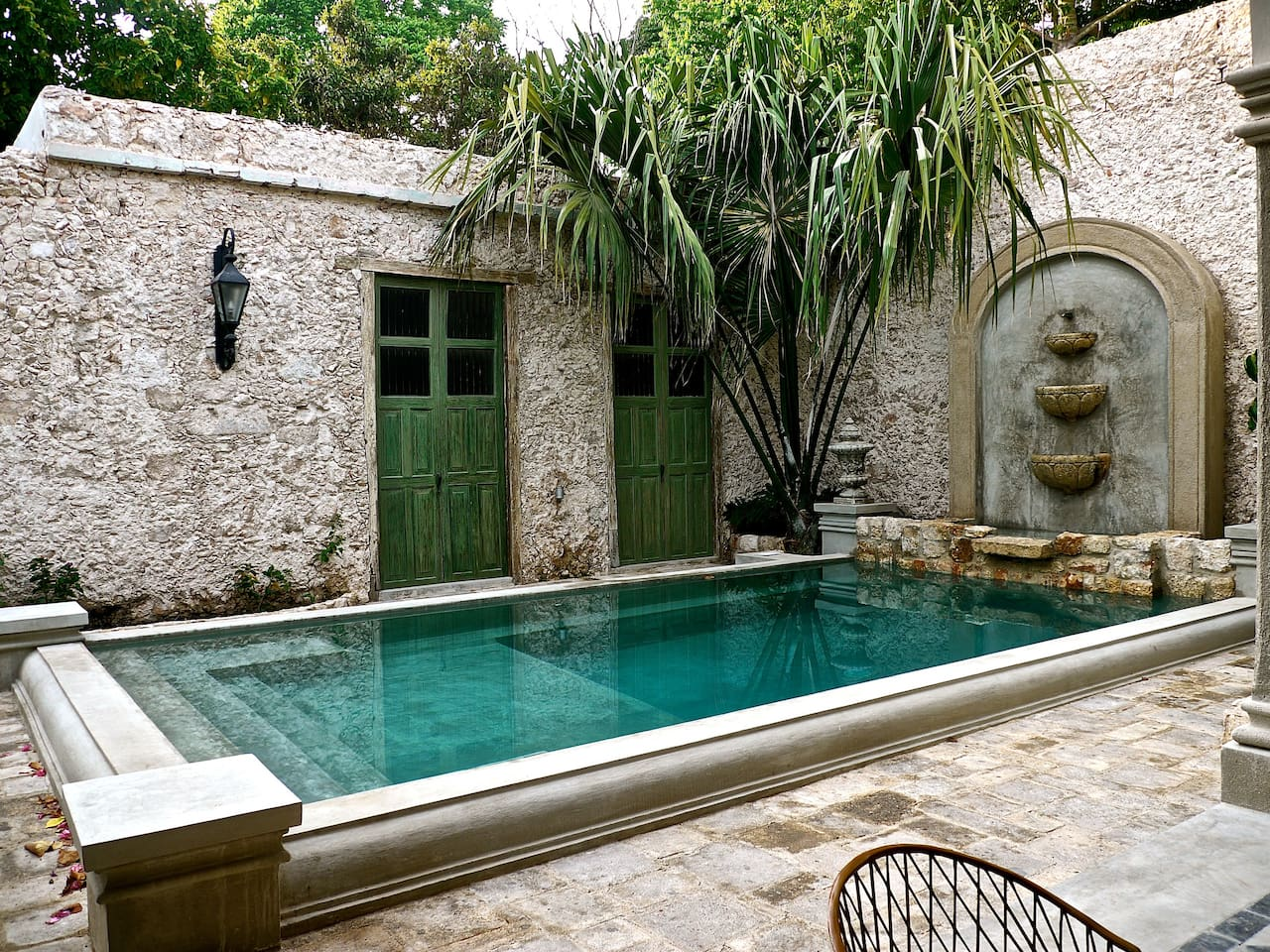 Opens to pool area in front and garden in back!