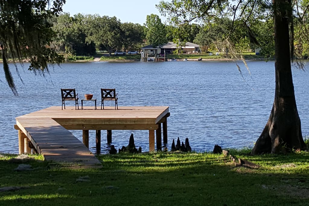 We have a new dock for fishing and sunsets. Check out the old cypress knees to the right.