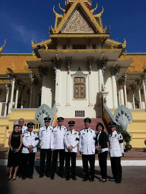 Tommy and Serena with St John Ambulance brigade in front of the Royal Palace before presenting their respect to the king.