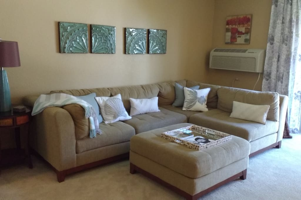 Large couch that can be used as bed. See photos. Extra sheets and pillows provided.