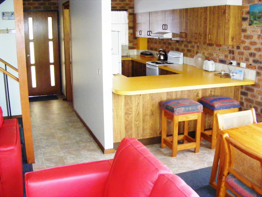 Fully equipped kitchen with dishwasher and microwave.