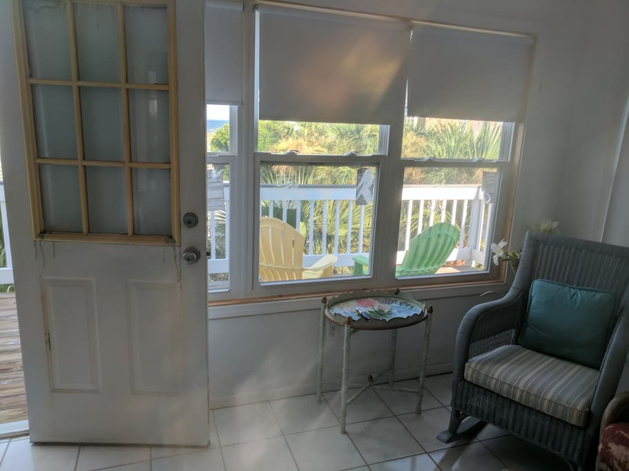 Check out the upper deck with ocean view through this door.  With all that ocean breeze you may want to bring your sunscreen in case you feel inspired to catch some rays.