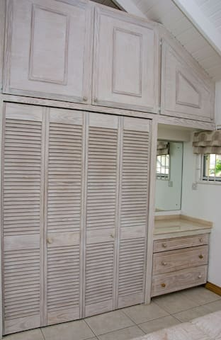 bedroom closets and vanity. Safe inside the closet