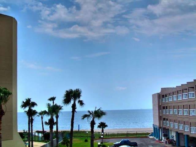 Beachview condo next to the swimming pool