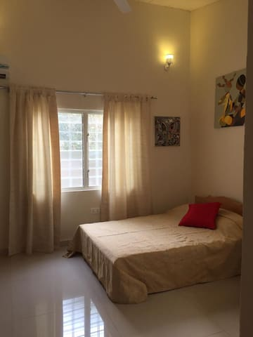 Comfortable double bed with new mattress. The whole studio is tastefully decorated with local artwork
