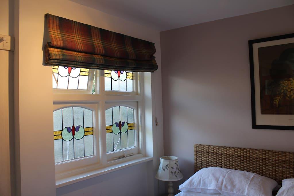 Antique window next to bed !