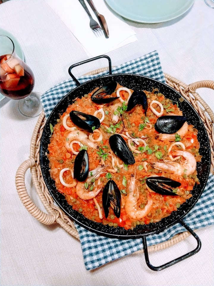 One of our first paella made by our host