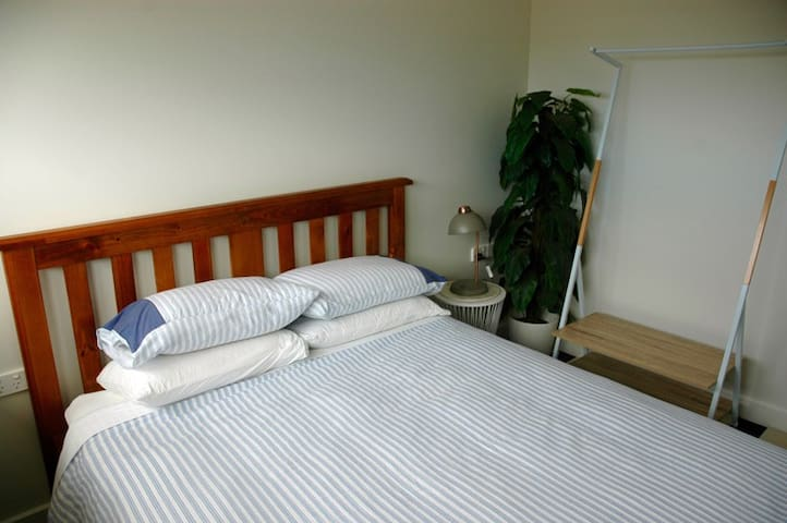 Queen bed with private bathroom