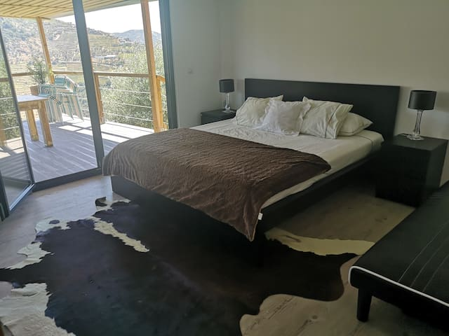 First bedroom with King size bed and sofa bed (only 1 person, very comfortable) with spectacular views.