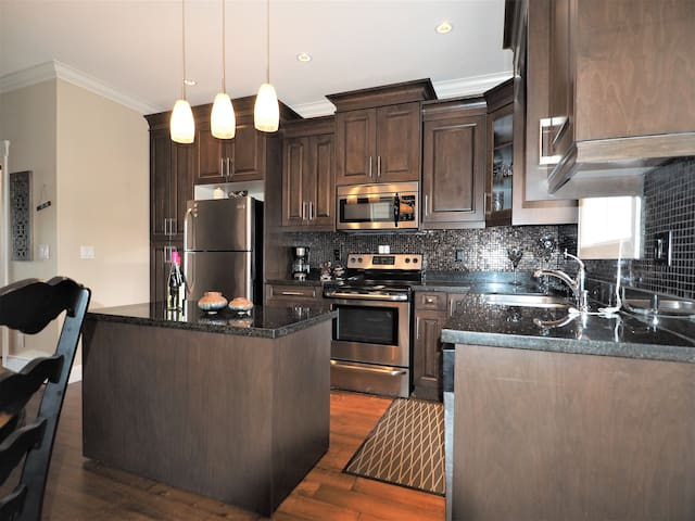 Granite counter tops and stainless steel appliances make this kitchen a dream to cook in.