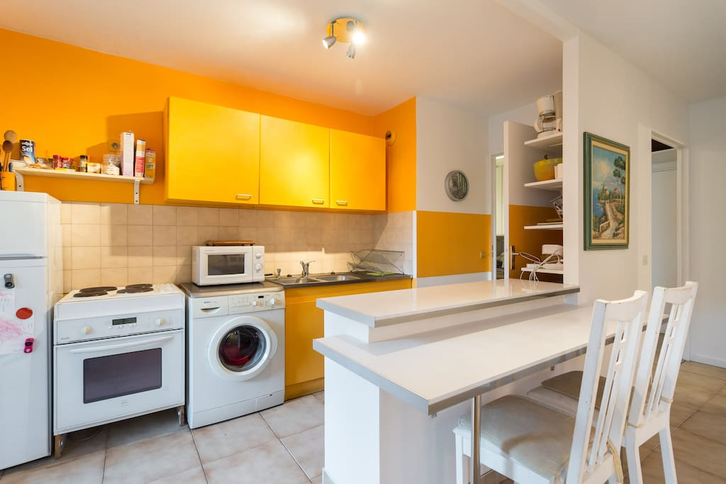 Kitchen with island that separates it from living room
