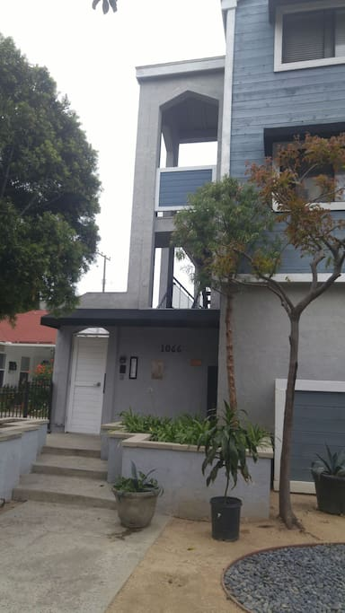 Condo w gated door on tree lined street with parking Read Signs!