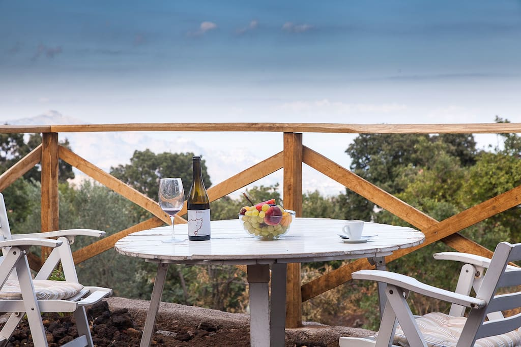 Enjoy wine while looking over the bay of Taormina