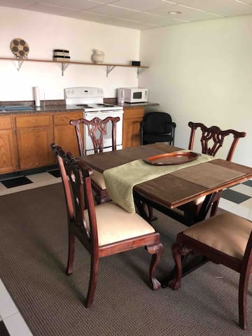 Kitchen: microwave, stove, refrigerator, coffee maker & lots of plates & utensils