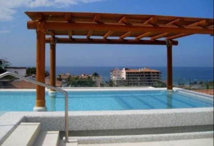 Infiniti Pool with Views of Ocean and Town