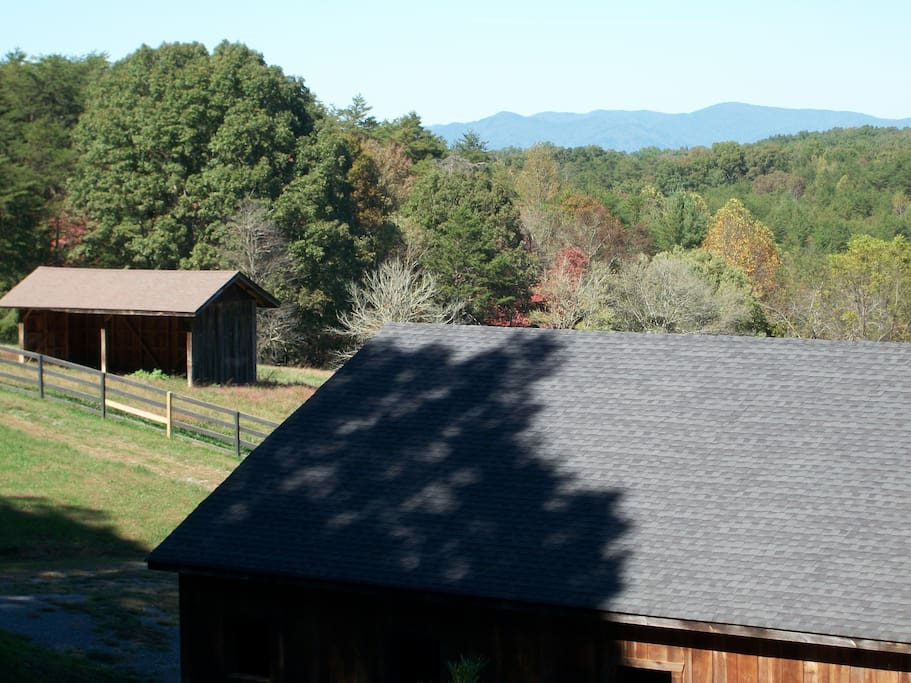 Cohutta Mountains as seen over the stable roof when driving on Damascus Trail to the Bunkhouse.