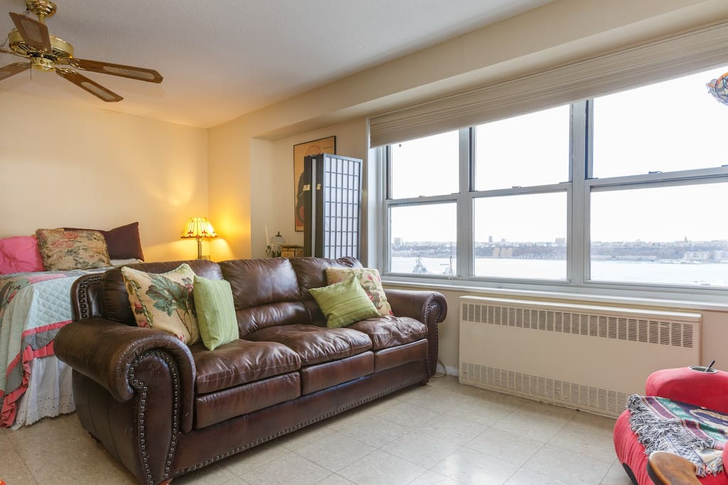 Sun-drenched living space.  The couch is also a fold out double bed. This is where the guest sleeps with fresh linens.
