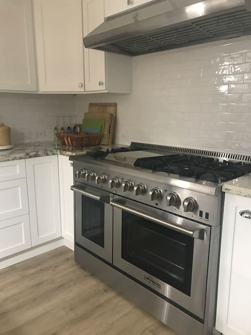 Chef's Kitchen Stove/Oven & Backsplash; Kitchen has lots of utensils and cookware
