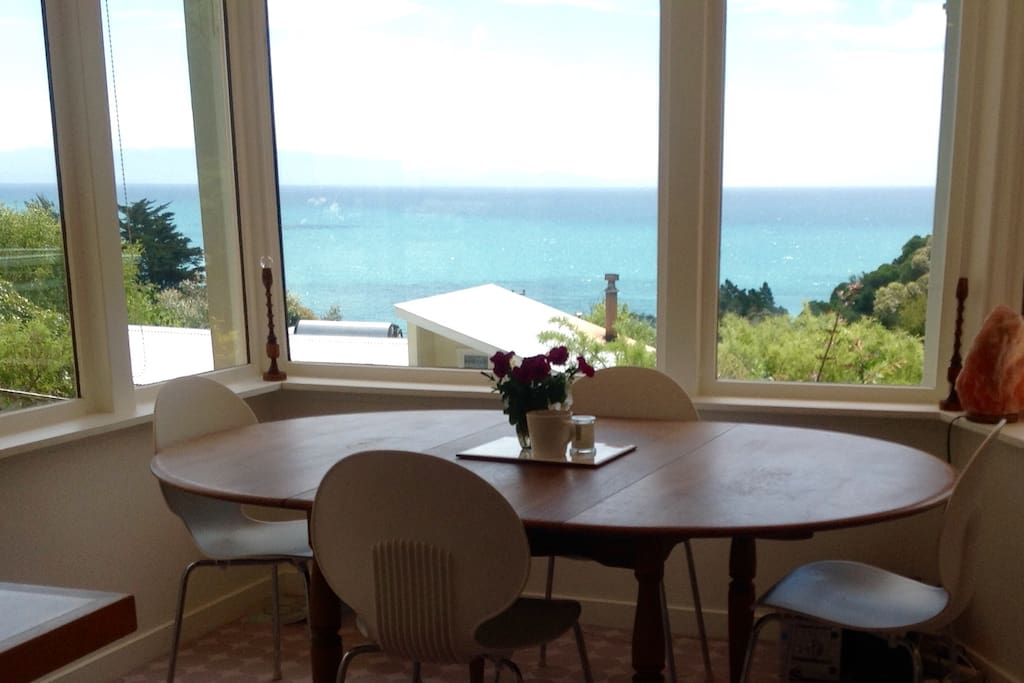 Dining table with view (the sea looks much closer in real life!).