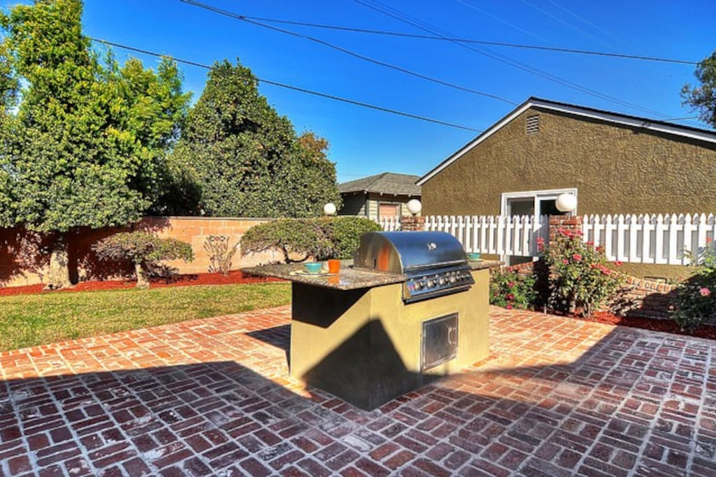 """Feel like dining """"out?""""  Grill burgers, steaks or vegies on the built-in BBQ."""