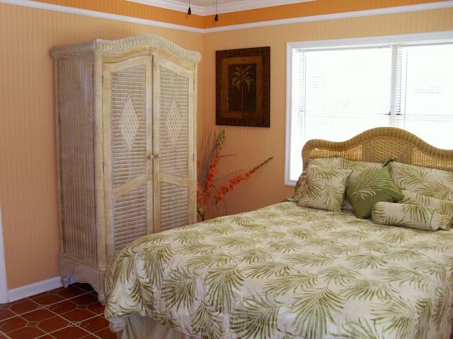 Queen bedroom. This bedroom has its own half bath and wardrobe (shown in photo). Each bedroom has flat screen TV.