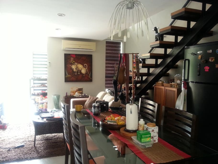 a view of the living room and dining area