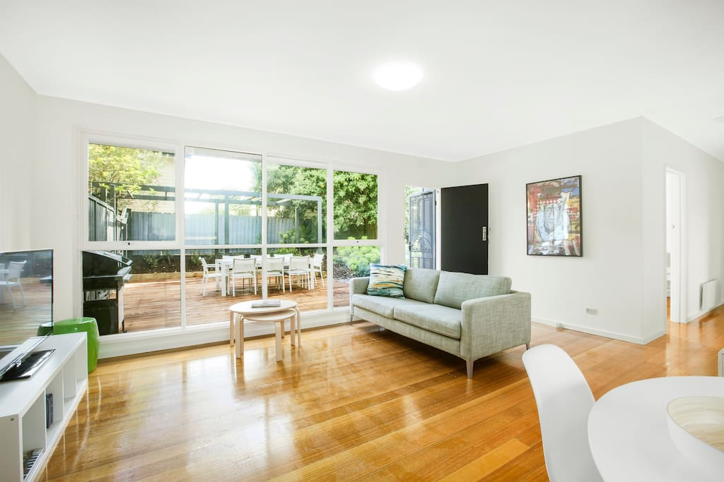 Living room with great light and outlook to private outdoor area and garden.
