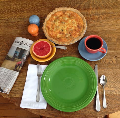 A typical breakfast: Quiche, scones, fruit, coffee and the New York Times.