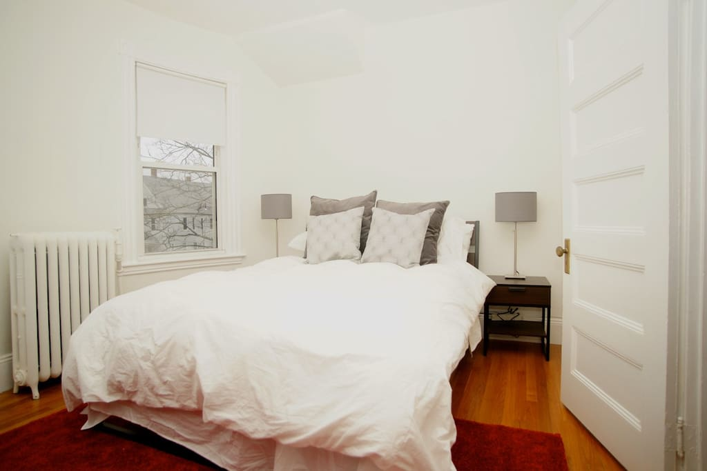 Bedroom with queen bed, tons of pillows and plush comforter!