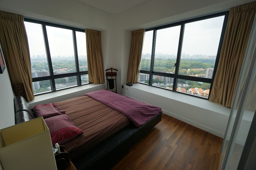 King size bed with unobstructed city views