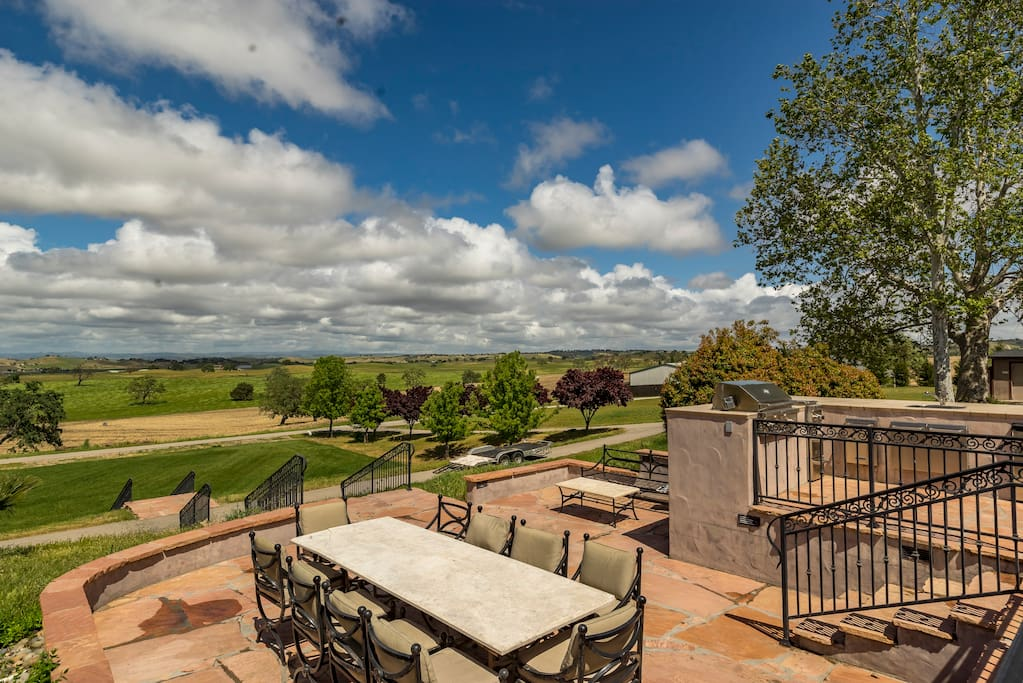 Expansive views of rolling hillsides dotted with oaks.  There is also an outside cooking area.