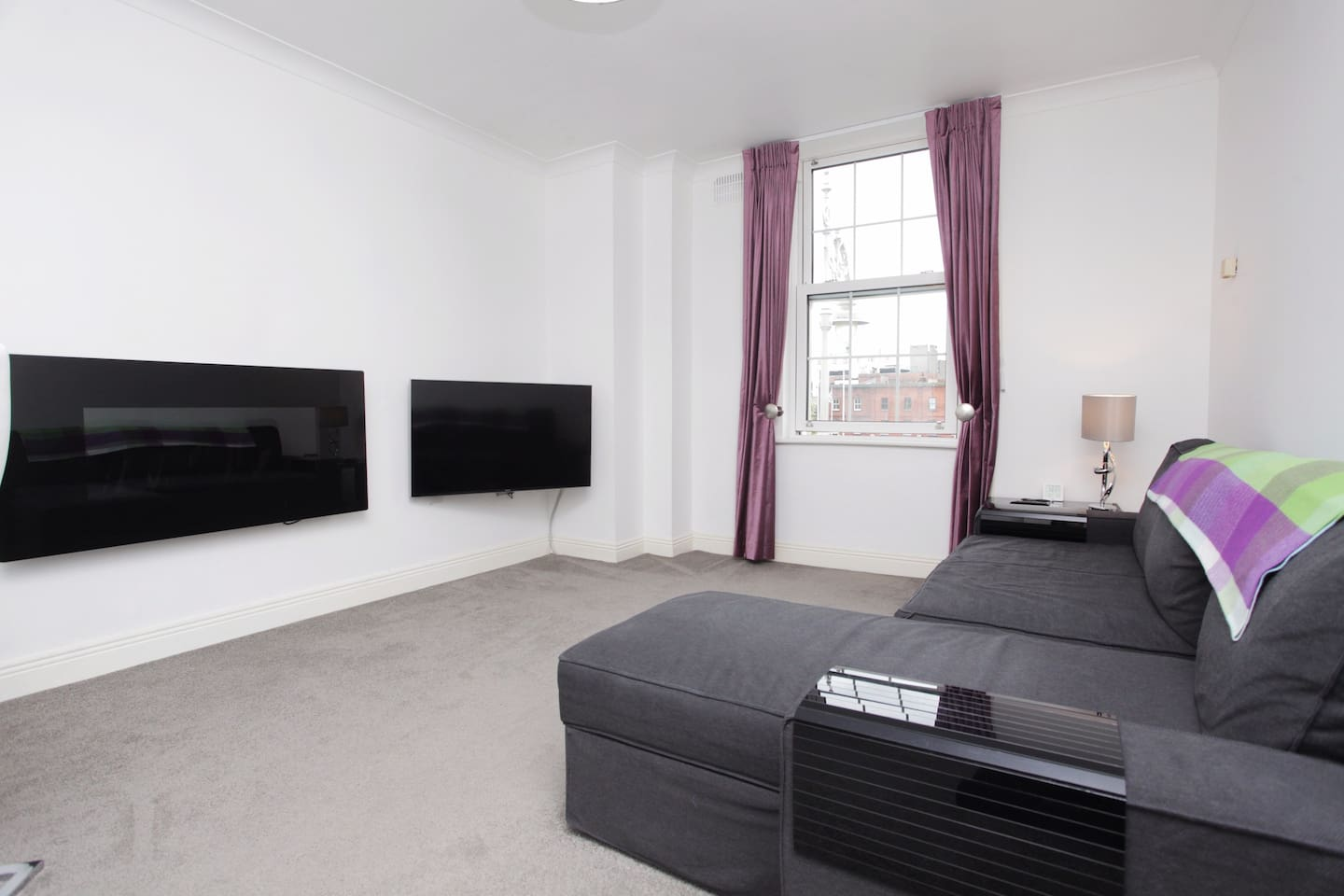 Large living area with sofa bed and Smart TV