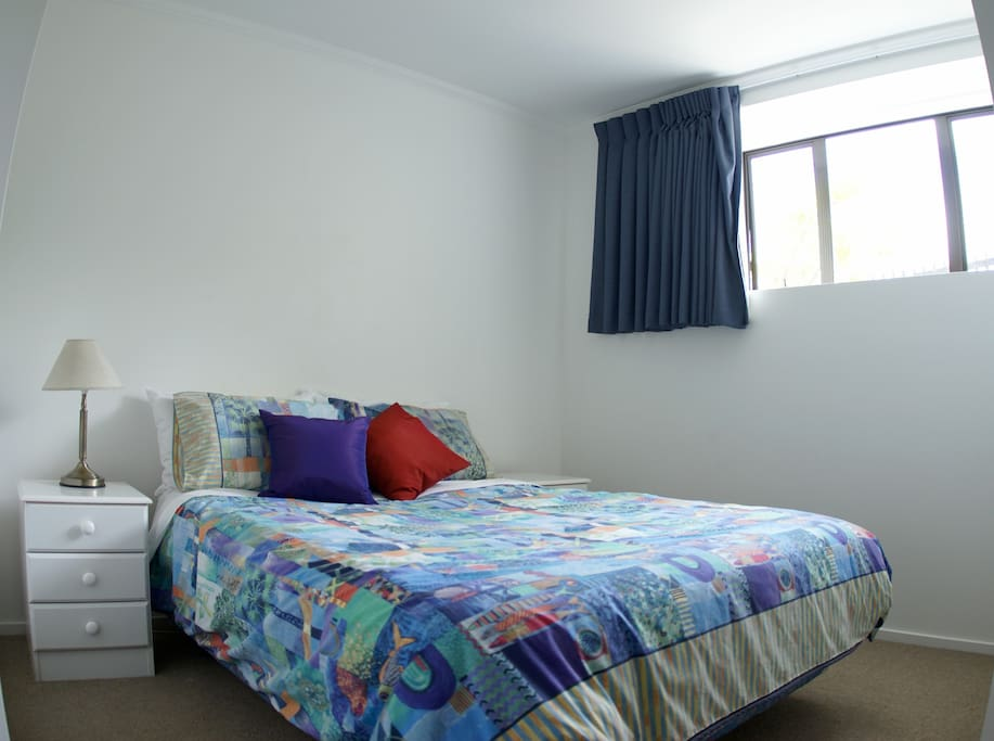 Bedroom 1 with queen sized double bed receives afternoon sun