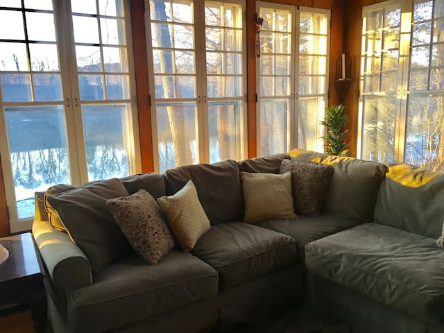 Fireplace room with comfy couches and what a view!