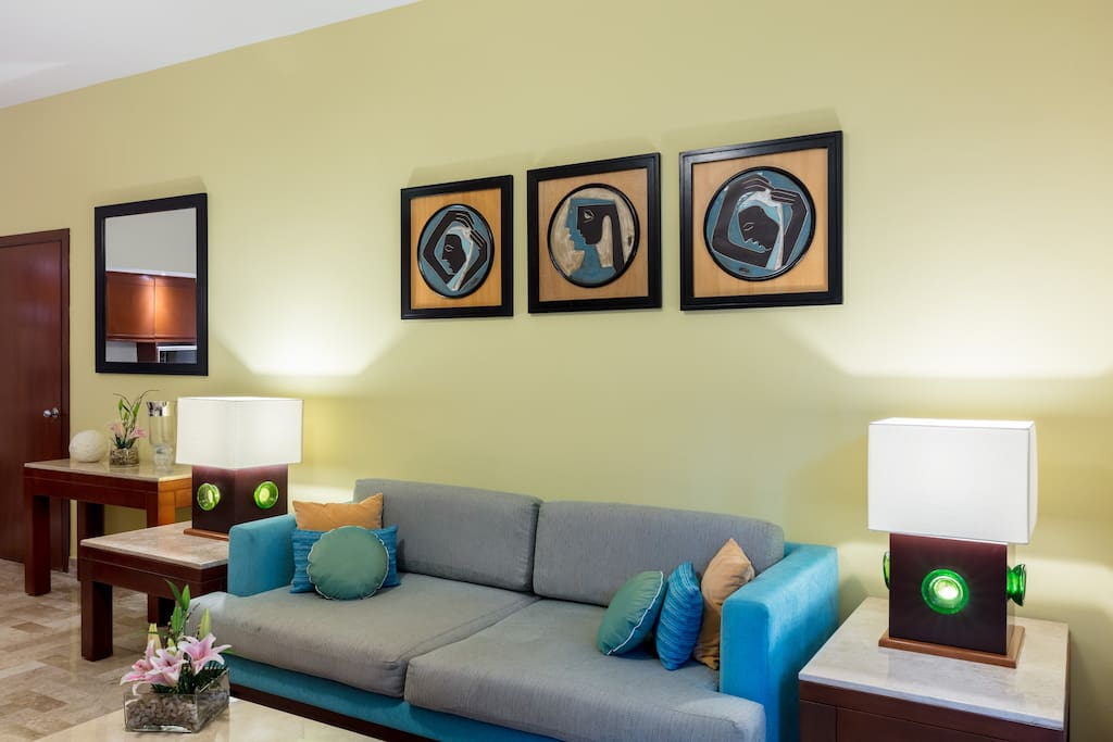 Splashes of tropical color and Mexican-inspired accents are featured in the living area.